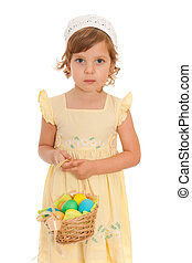Serious little girl with Easter basket