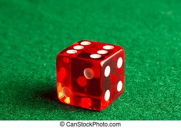 one dice on gaming table