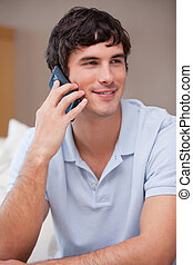 Man answering phonecall - Young man answering phonecall