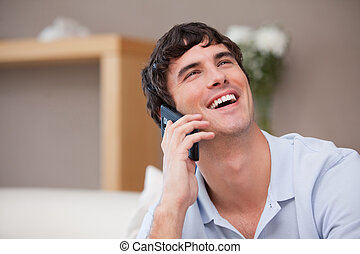 Man on the phone laughing - Young man on the phone laughing