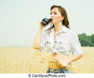 Girl  with kvass at  field