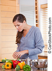 Woman in the kitchen preparing a healthy meal - Young woman...