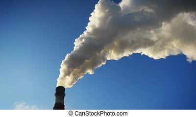 Exhaust smoke - Coal-burning power plant at winter