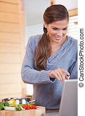 Woman looking up a recipe on the internet