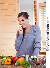 Woman in the kitchen with vegetables - Young woman in the...