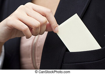 Asian woman holding a blank business card