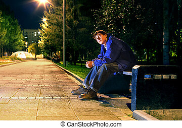 teenager in the night - lonely teenager sitting in the night...