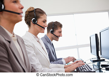 Side view of customer service department at work