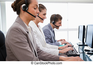 Side view of customer service employees at work