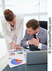 Businesswoman explaining research results to colleague