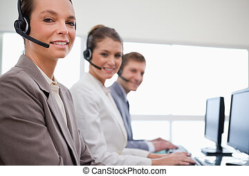 Side view of customer service team at work