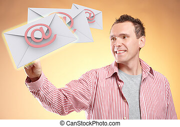 Flying emails - Man with hand on email messages flying,...