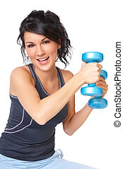 Young woman with dumbbell - Young woman doing exercise with...