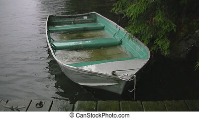 Sinking fishing boat. Two shots. - A waterlogged fishing...