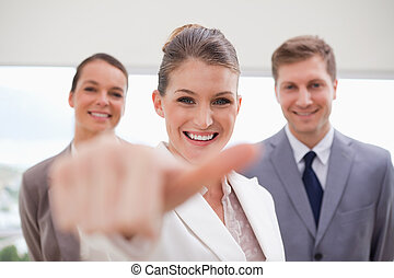 HR Manager about to give thumb up - HR Manager with team...