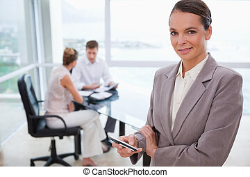 Business consultant with cellphone