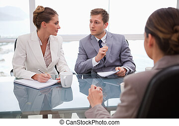 Business team deliberating with lawyer - Business team...