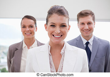 Marketing manager standing with her team behind her