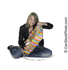 sitting cute girl unwrapping a present - Studio photography...