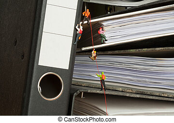 Miniature people climbing binders - Miniature people group...