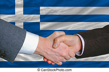 businessmen handshake after good deal in front of greece...