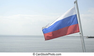 Russian flag flutters on nature - Russian tricolor flag...