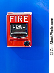 fire alarm switch on blue wall