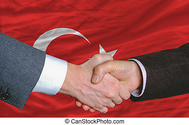 businessmen handshake after good deal in front of turkey...