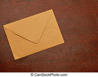 old postal envelope on wooden background