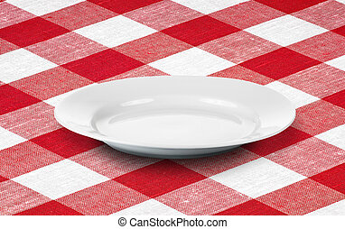 white empty plate on red gingham tablecloth