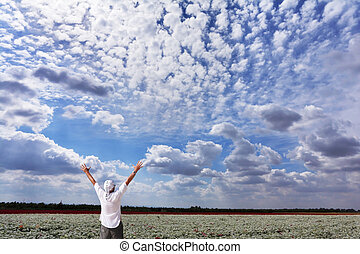 A man delighted with the beauty of a cloudy sky - A man in a...