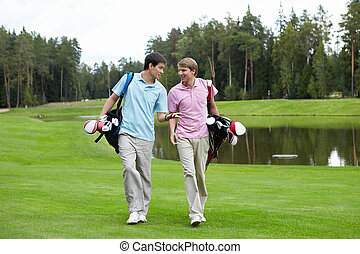 Young men - Two young men on the golf course
