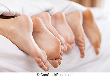 Close up of family feet in a bedroom