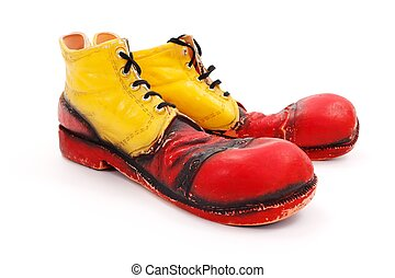 Clown shoes - Very big red-yellow clown shoes on white