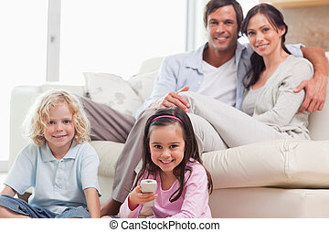 Lovely family watching television in a living room