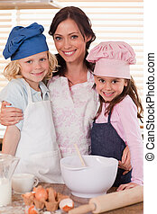 Portrait of a mother and her children baking