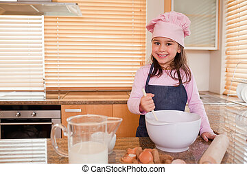 Cute girl baking
