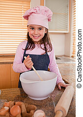Portrait of a girl baking in a kitchen