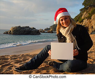 Christmas beach ad - young caucasian woman on the beach...
