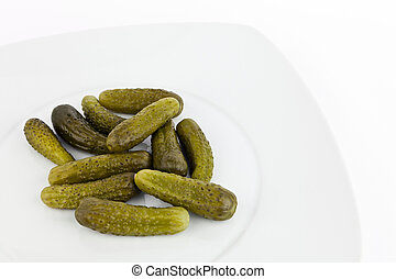 Pickled cucumbers. - Pickled cucumbers in dish on white...
