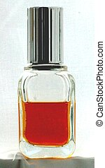 SMALL PERFUME BOTTLE - A small perfume bottle against a...