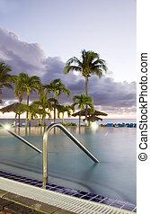 large luxury infinity swimming pool  dusk sundown hotel St. Maarten St. Martin Caribbean Island