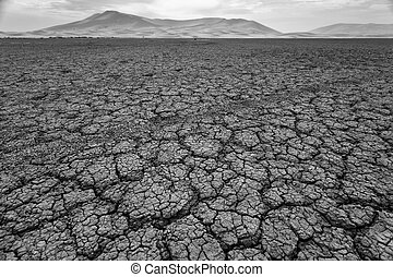 Cracked pattern of dry lake bed in Sahara Desert Morocco in black and white
