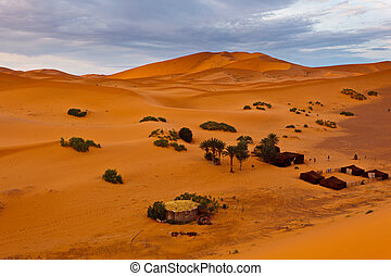 Bedouin encampment on sand dune in Sahara Desert Morocco