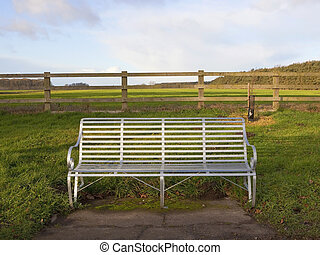 silver seat - a rural landscape with a silver metal bench...