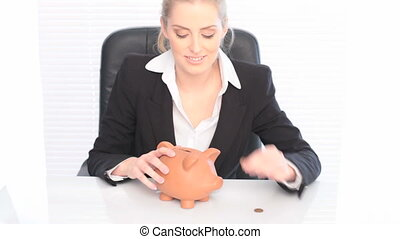 Businesswoman With Piggy Bank and coin in savings concept