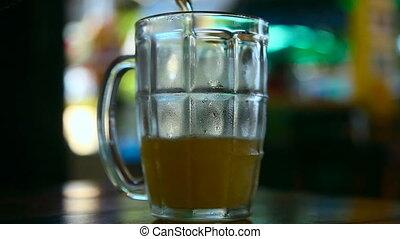 Beer. - Beer in a glass mug.