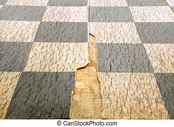 Old crackled chessboard, for backgrounds or textures