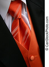Orange Tie Tux - A closeup image of an orange tie, vest and...