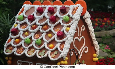 Gingerbread house - Giant Gingerbread house decorated with...